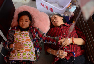 Injured people receive treatment at temporary medical tents in Baosheng